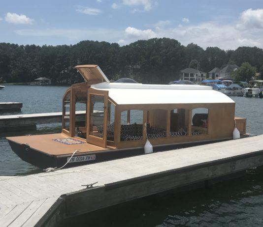 Woody Houseboat docked